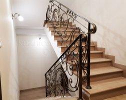 Перила, кованые для лестницы с поворотом