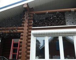 Ограждение балкона кованой лозой